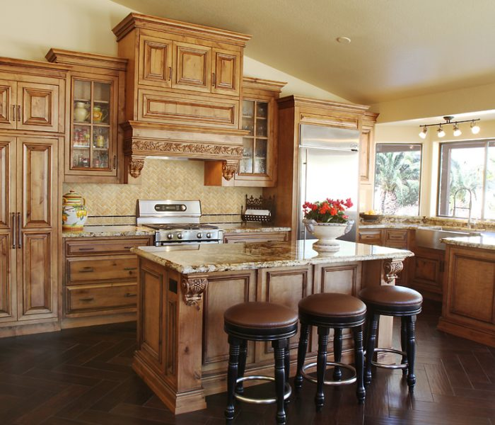 traditional style kitchen in natural wood stain with natural stone quartz countertops