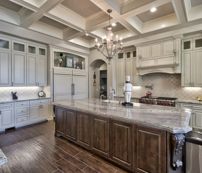 traditional kitchen in two tone white and antique wood stain with natural stone quartz