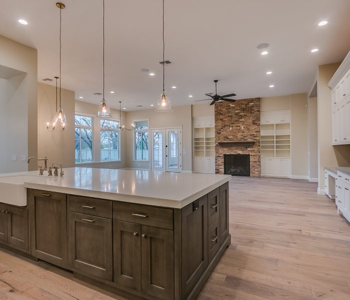 transitional style kitchen in two tone antique wood stain and white with white quartz countertops