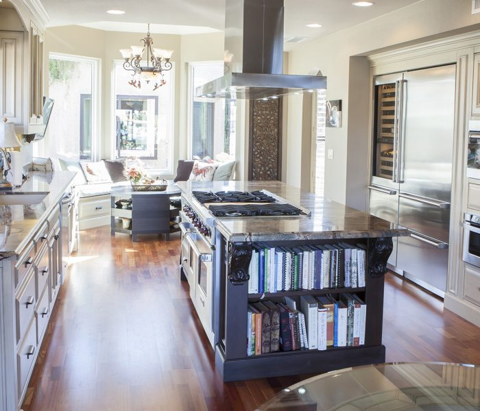 transitional style kitchen in two tone black and white paint with natural stone quartz countertop