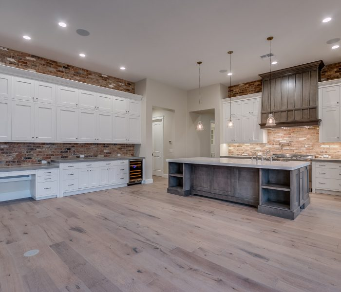 transitional style kitchen in white with gray stone quartz countertop
