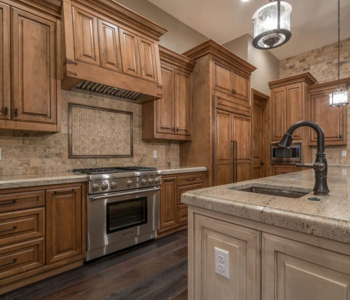 transitional style kitchen in two tone dark and light antique wood stain