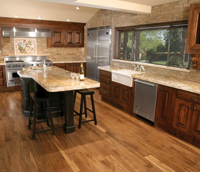 transitional style kitchen in dark wood stain with natural stone quartz and brick