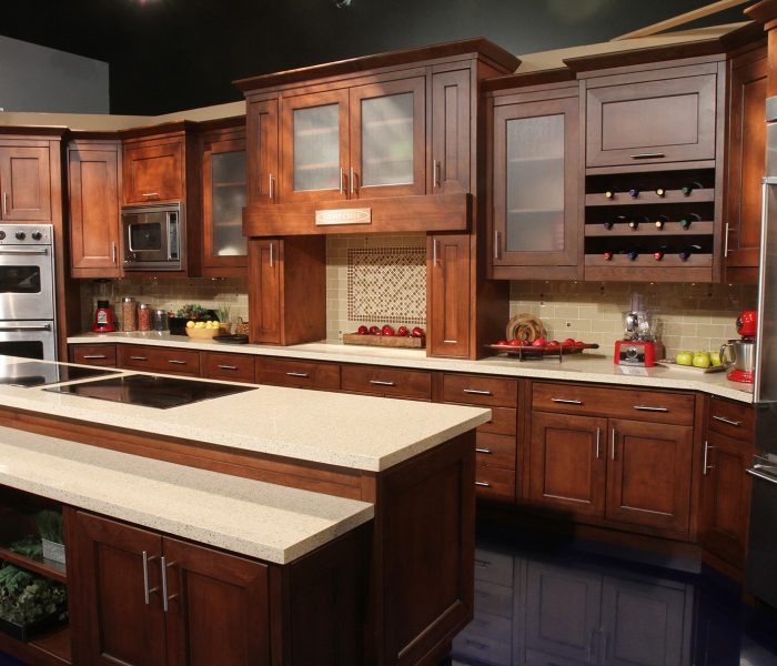 transitional style kitchen in dark wood stain with white quartz countertops