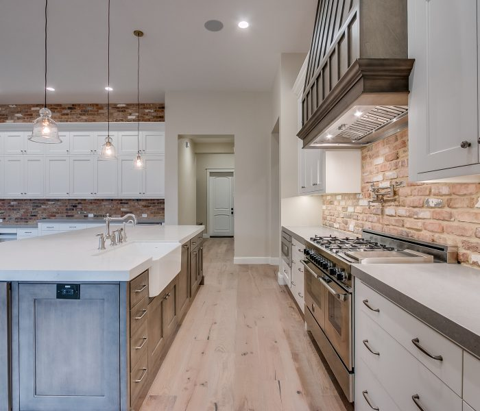 transitional style kitchen in white and gray with antique wood stain island
