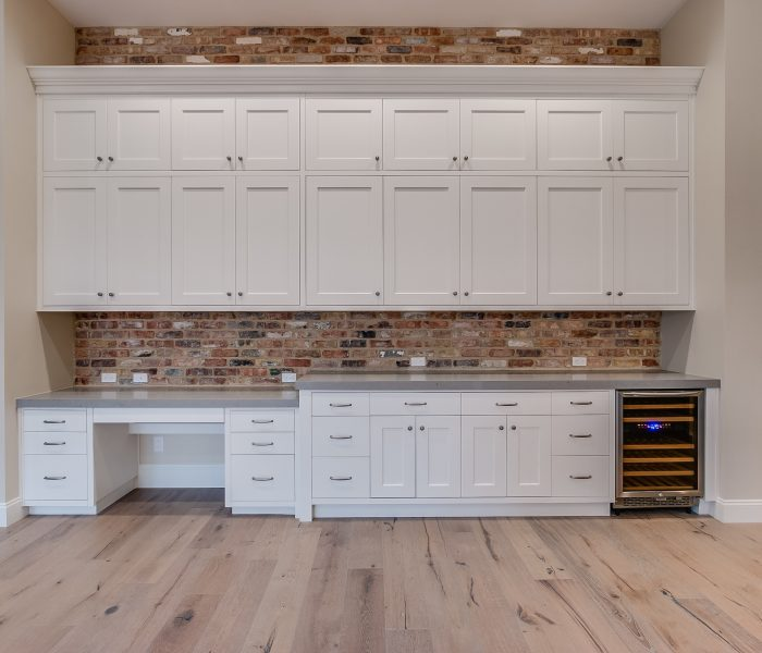 transitional style kitchen hutch with desk in white with gray stone quartz countertop