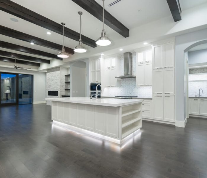 transitional style kitchen dining in white with white quartz countertops