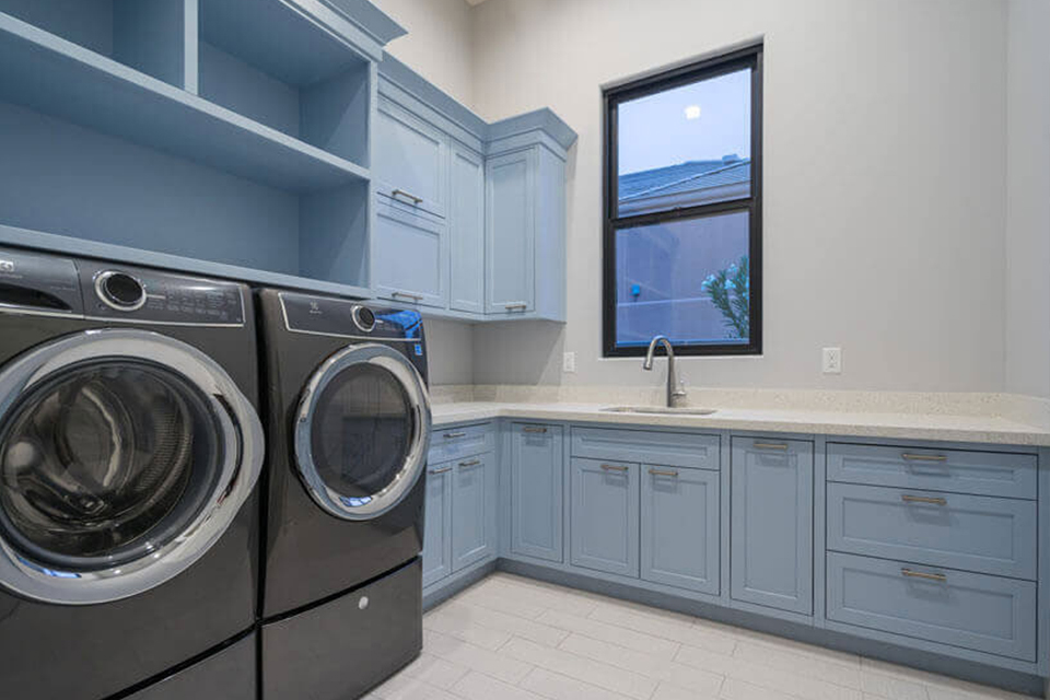 shaker style laundry cabinetry in blue