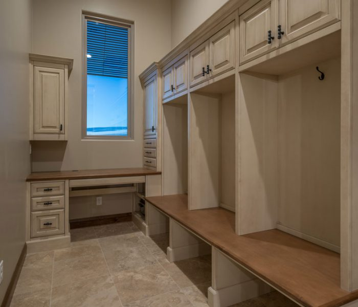 shaker style laundry room in antique wood stain