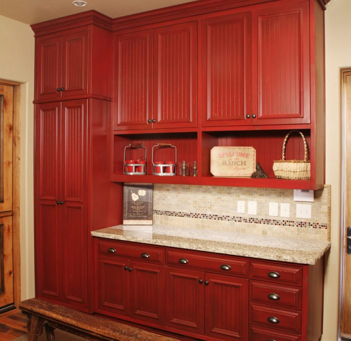 transitional style laundry room in red with quartz