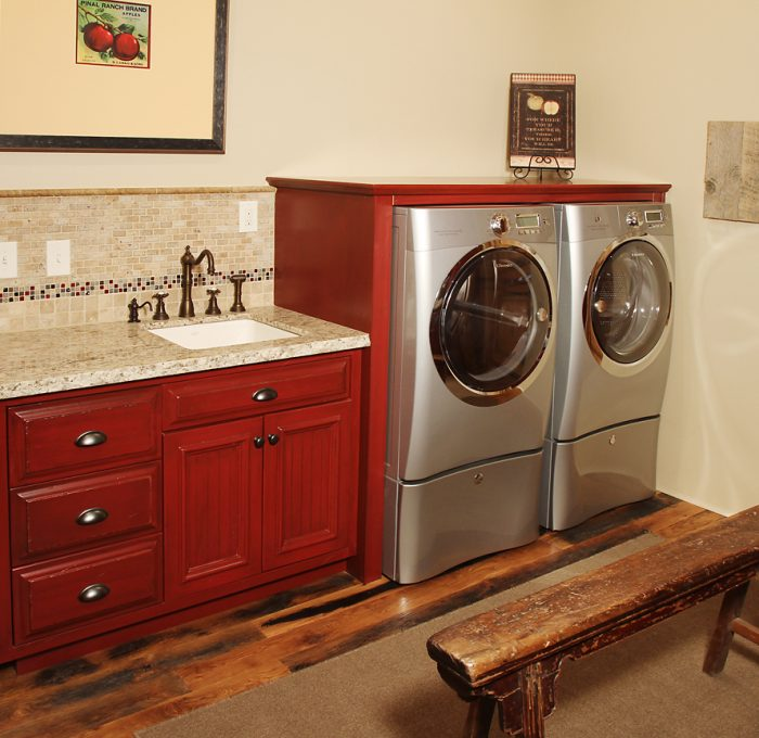 transitional style laundry room in red with quartz counter top