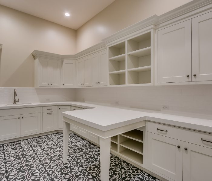 transitional style laundry room in white