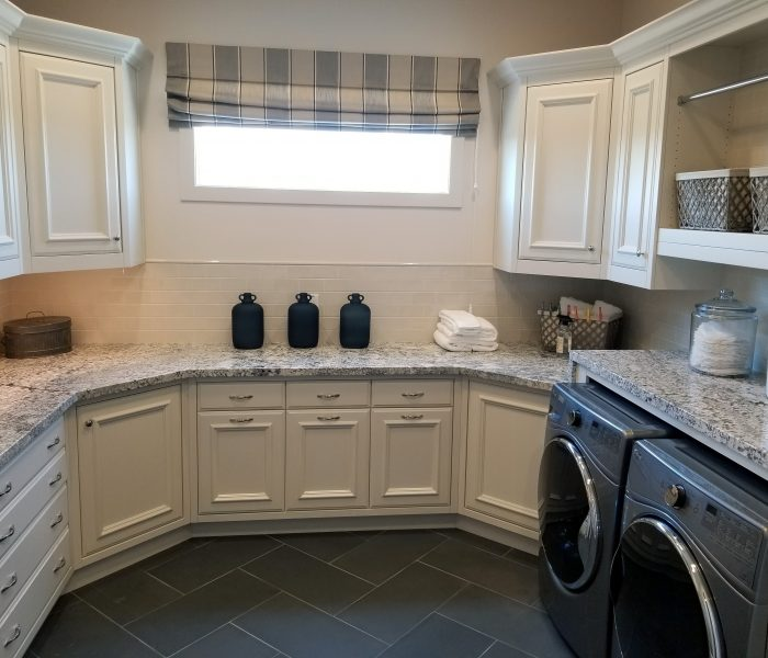 transitional style laundry room in white with quartz counter tops