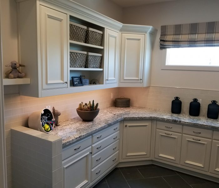 transitional style laundry room in white with quartz countertop