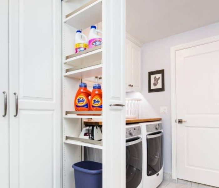 shaker style laundry room cabinetry pull out shelves in white