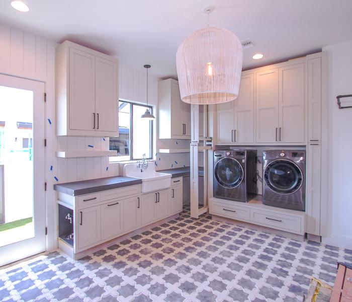 custom-laundry-white-cabinets-dark-countertop
