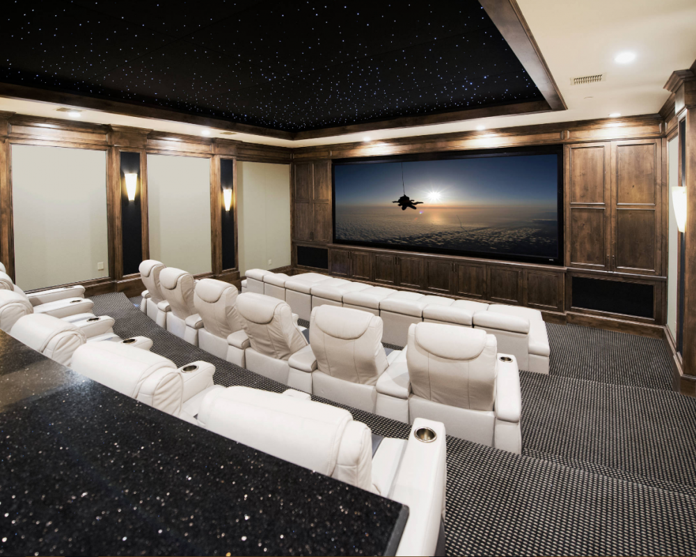 traditional style media wall theatre room in dark wood stain and white