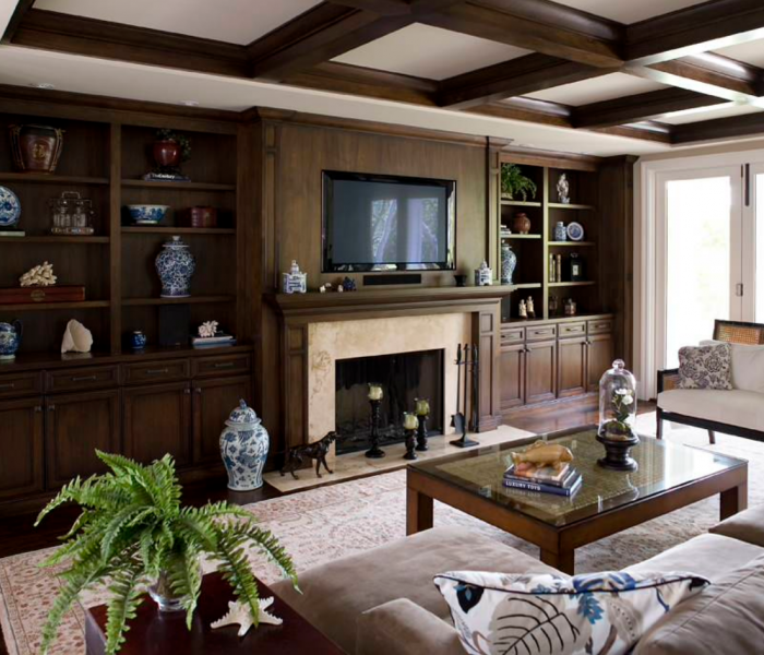 traditional style built in media wall in dark wood stain with fireplace