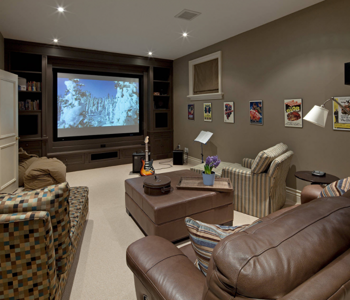 modern media wall in dark wood stain built in theatre