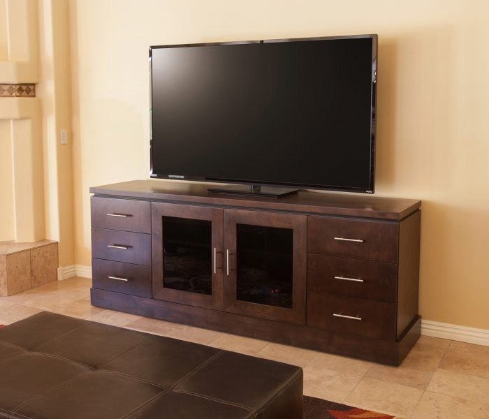 transitional style media wall in dark wood stain