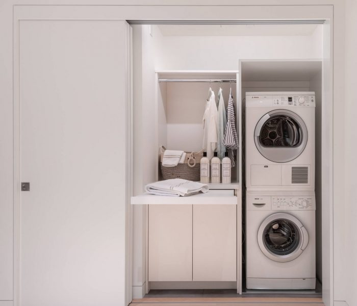 modern clean laundry room closet in white