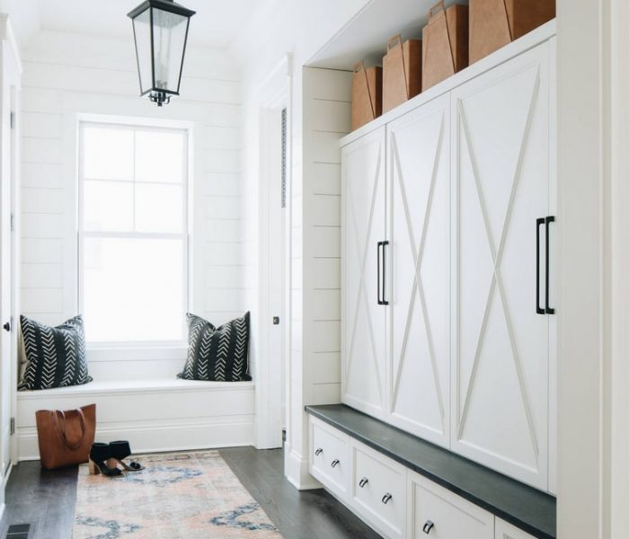 shaker style mudroom cabinetry in white with black painted bench