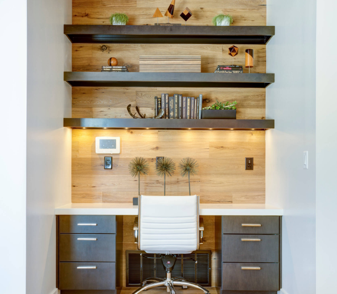 modern office desk built in to nook in two tone wood stain