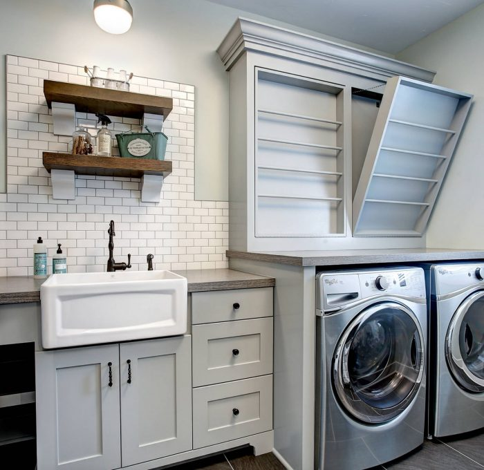shaker style laundry room cabinetry in gray with white porcelain accents