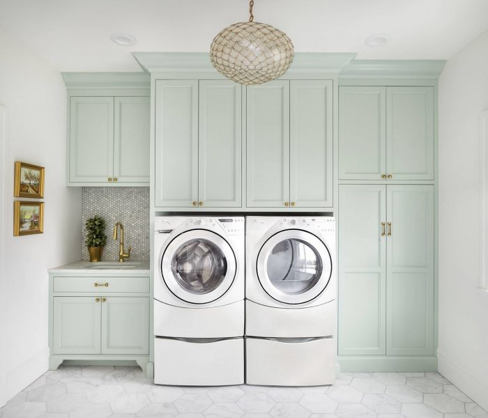 traditional laundry room cabinetry in teal