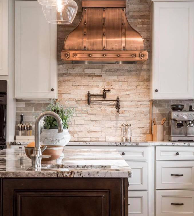 transitional style kitchen in white with copper hood