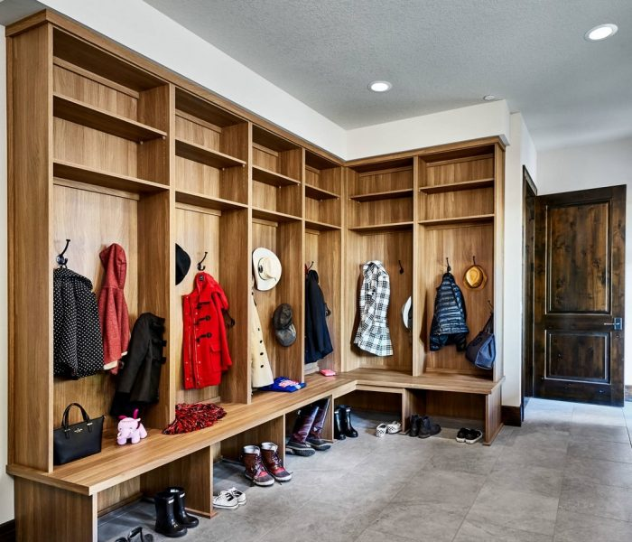 transitional mudroom cabinetry in natural wood stain