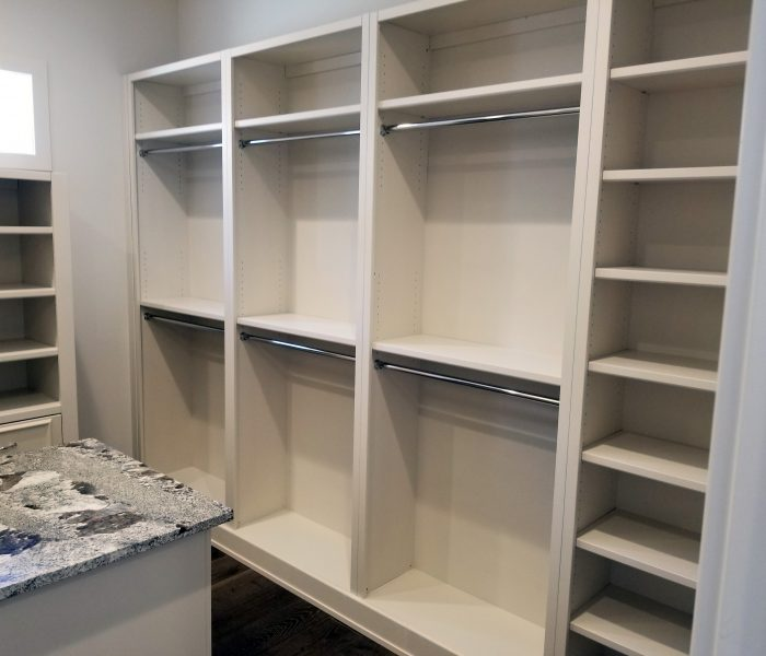 modern style closet in white with closet island